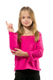 Adorable little girl holding index finger up. Isolated on white Royalty Free Stock Photo