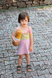 Adorable little girl holding  a loaf of bread Royalty Free Stock Photography
