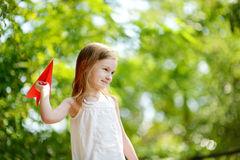 Adorable little girl holding a paper plane Royalty Free Stock Photography