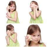 Adorable little girl holding sea shell Royalty Free Stock Image