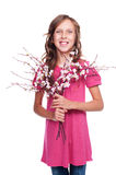 Adorable little girl holding spring flowers stock photography