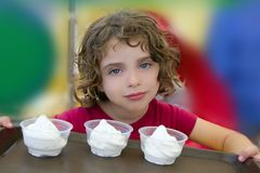 Adorable little girl holding three ice cream stock image