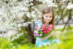 Adorable little girl holding tulips Stock Photos