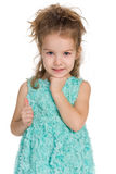 Adorable little girl holds her thumb up Royalty Free Stock Image