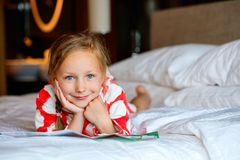 Adorable little girl at home Stock Photo