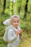 Adorable little girl hugs her favorite soft toy in a summer day in the park Stock Photo