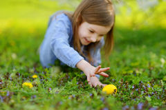 Adorable little girl hunting for an egg on Easter Royalty Free Stock Photo