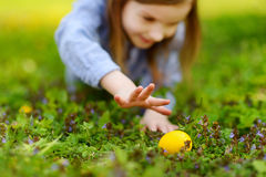 Adorable little girl hunting for an egg on Easter Royalty Free Stock Image