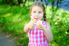 Adorable little girl with ice cream on summer day. Adorable little girl with ice cream on sunny summer day Stock Photos