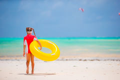 Adorable little girl with inflatable rubber circle during beach vacation. Kid having fun on summer active vacation Royalty Free Stock Photos