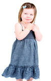 Adorable little girl isolated on white. With hands folded Stock Image