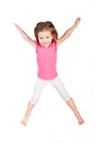 Adorable little girl jumping in air isolated Stock Photo