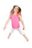 Adorable little girl jumping in air isolated Stock Images