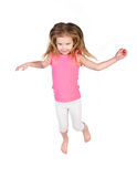 Adorable little girl jumping in air isolated Royalty Free Stock Image