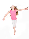 Adorable little girl jumping in air isolated Royalty Free Stock Photography