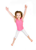 Adorable little girl jumping in air isolated Stock Image