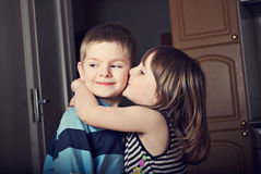 Adorable Little Girl Kissing A Boy Stock Images