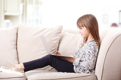 Adorable little girl with laptop Stock Photo