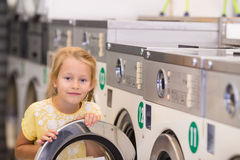 Adorable little girl in laundry room Royalty Free Stock Image