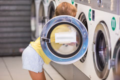Adorable little girl in laundry room Stock Images