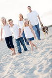 Adorable Little Girl Leads Her Family on a Walk Royalty Free Stock Photo