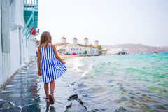 Adorable little girl at Little Venice the most popular tourist area on Mykonos island, Greece. Beautiful kid smile and Royalty Free Stock Photography
