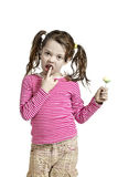 Adorable little girl with a lollipop Royalty Free Stock Image