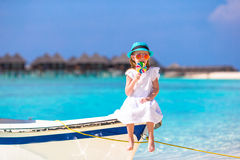 Adorable little girl with lollipop sitting on boat Stock Photography