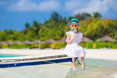Adorable little girl with lollipop on tropical Stock Photo