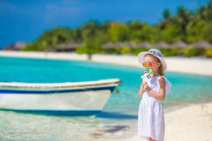 Adorable little girl with lollipop on tropical Royalty Free Stock Photography