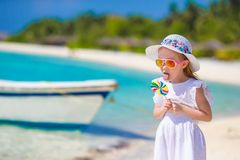 Adorable little girl with lollipop on tropical Stock Image