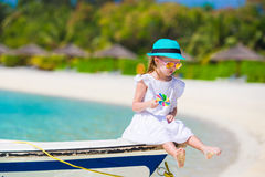 Adorable little girl with lollipop on tropical Stock Photography