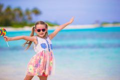 Adorable little girl with lollipop on tropical Royalty Free Stock Images