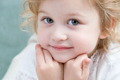 Adorable little girl looking ahead. Close-up Royalty Free Stock Images