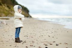 Adorable little girl looking at ocean Stock Photo