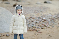 Adorable little girl looking at ocean Royalty Free Stock Image