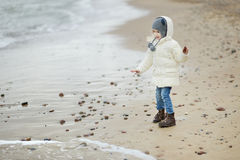 Adorable little girl looking at ocean Royalty Free Stock Images