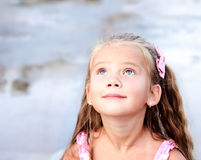 Adorable little girl looking up stock image