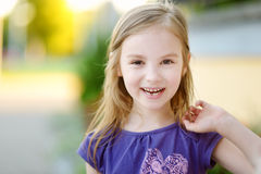 Adorable little girl lost her tooth Stock Images