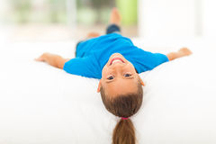 Adorable little girl. Lying on bed at home Royalty Free Stock Photography