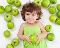 Adorable Little Girl Lying With Green Apples Stock Image