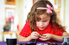 Adorable little girl making crafts Stock Images