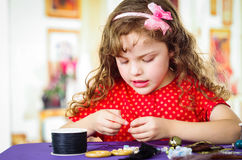 Adorable little girl making crafts Stock Image