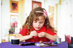Adorable little girl making crafts Royalty Free Stock Photo