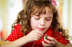 Adorable little girl making crafts Stock Photography