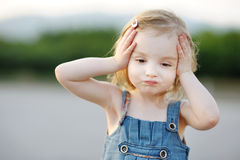 Adorable little girl making funny face Royalty Free Stock Photos