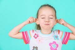 Adorable little girl making funny face. Grimacing concept Stock Image