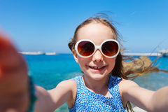 Adorable little girl making selfie outdoors Royalty Free Stock Photography