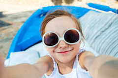 Adorable little girl making selfie outdoors Royalty Free Stock Images