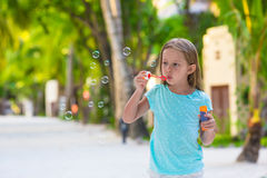 Adorable little girl making soap bubbles during Royalty Free Stock Images